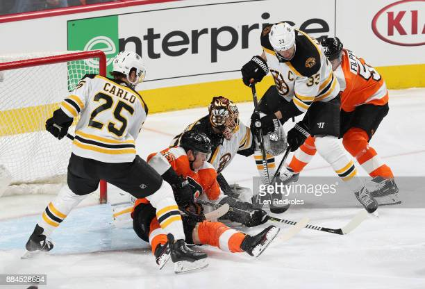 Brandon Carlo and Zdeno Chara of the Boston Bruins defend goaltender Tuukka Rask against Jori Lehtera and Valtteri Filppula of the Philadelphia...