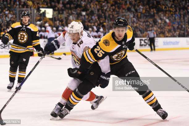 Brandon Carlo of the Boston Bruins against Aleksander Barkov of the Florida Panthers at the TD Garden on March 31 2018 in Boston Massachusetts
