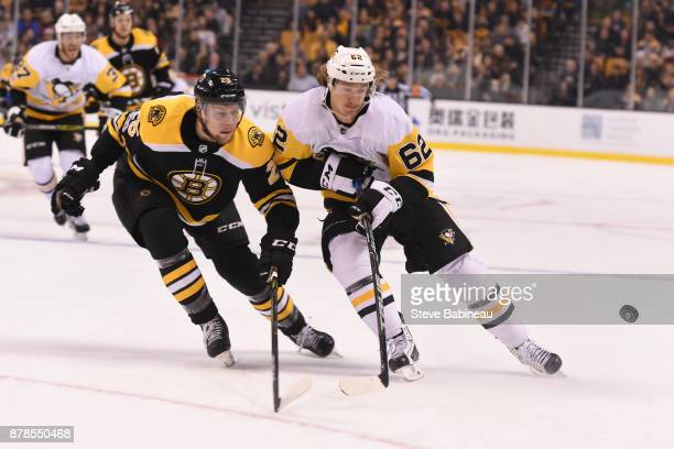 Brandon Carlo of the Boston Bruins against Carl Hagelin of the Pittsburgh Penguins at the TD Garden on November 24 2017 in Boston Massachusetts