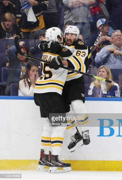 Brandon Carlo of the Boston Bruins celebrates his second period goal at 1419 with Brad Marchand against the St Louis Blues in Game Four of the 2019...