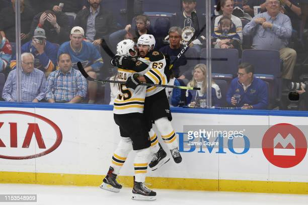 Brandon Carlo of the Boston Bruins celebrates his second period goal at 14:19 with Brad Marchand against the St. Louis Blues in Game Four of the 2019...