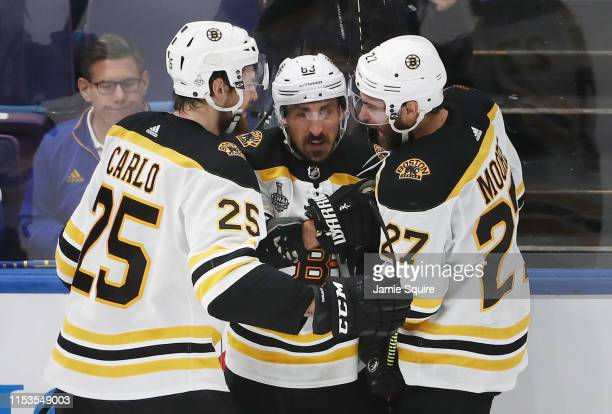 Brandon Carlo of the Boston Bruins celebrates his second period goal at 1419 with Brad Marchand and John Moore against the St Louis Blues in Game...