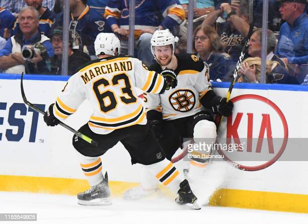 Brandon Carlo of the Boston Bruins celebrates his shorthanded goal with teammate Brad Marchand during the second period of Game Four of the 2019 NHL...