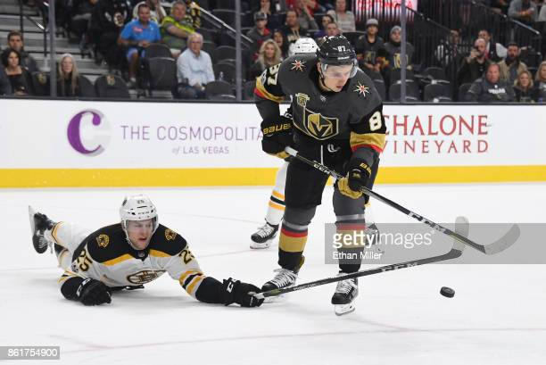 Brandon Carlo of the Boston Bruins dives for the puck against Vadim Shipachyov of the Vegas Golden Knights in the second period of their game at...