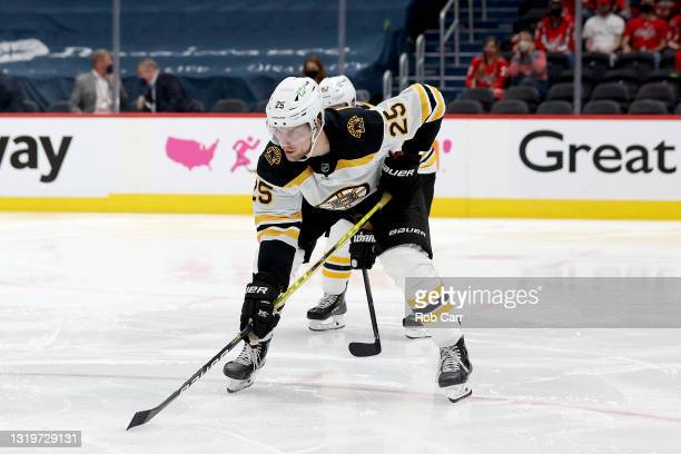 Brandon Carlo of the Boston Bruins follows the puck against the Washington Capitals during Game Five of the 2021 Stanley Cup Playoffs at Capital One...