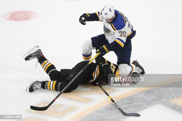 Brandon Carlo of the Boston Bruins is checked by Oskar Sundqvist of the St. Louis Blues during the second period in Game Seven of the 2019 NHL...