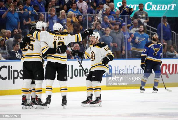 Brandon Carlo of the Boston Bruins is congratulated by his teammates after scoring a third period goal against the St. Louis Blues in Game Six of the...