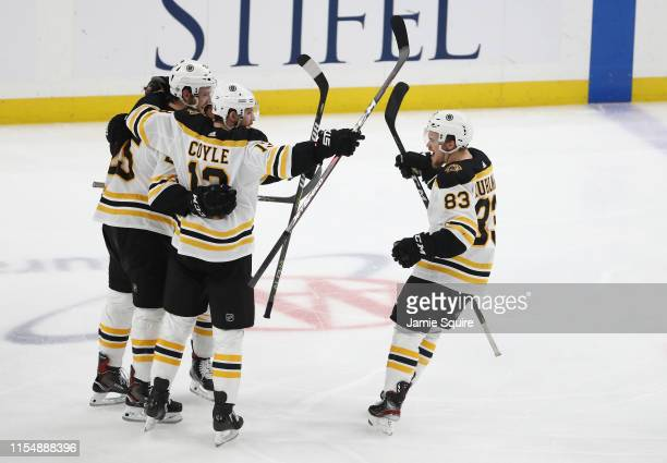 Brandon Carlo of the Boston Bruins is congratulated by his teammates after scoring a third period goal against the St Louis Blues in Game Six of the...