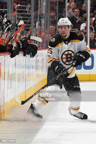 Brandon Carlo of the Boston Bruins keeps his eyes on the airborne puck against the Philadelphia Flyers on December 2 2017 at the Wells Fargo Center...