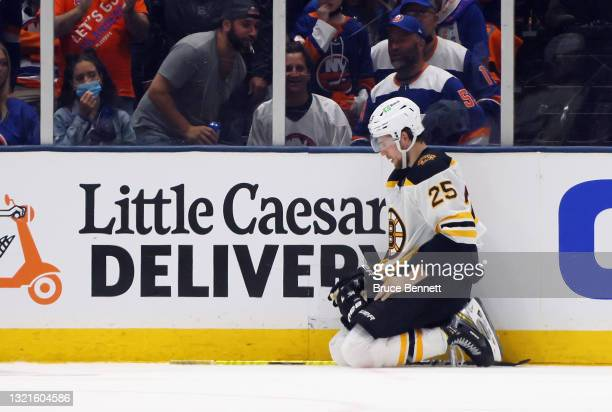 Brandon Carlo of the Boston Bruins pauses after a third period injury against the New York Islanders in Game Three of the Second Round of the 2021...