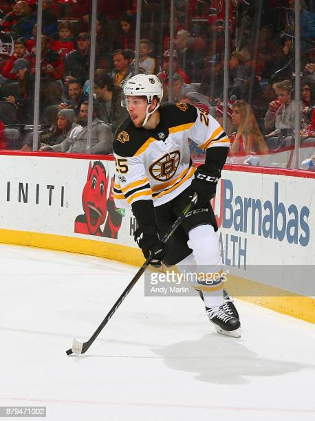 Brandon Carlo of the Boston Bruins plays the puck against the New Jersey Devils during the game at Prudential Center on November 22 2017 in Newark...