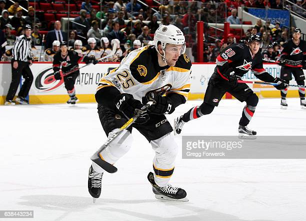 Brandon Carlo of the Boston Bruins prepares for a face off during an NHL game against the Carolina Hurricanes on January 8 2017 at PNC Arena in...