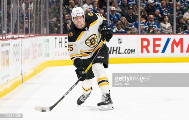 Brandon Carlo of the Boston Bruins shoots the puck during NHL action against the Vancouver Canucks at Rogers Arena on February 22, 2020 in Vancouver,...