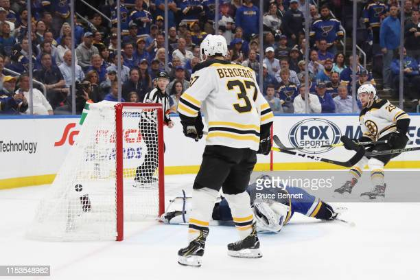 Brandon Carlo of the Boston Bruins shoots the puck past Jordan Binnington of the St Louis Blues for a second period goal at 1419 in Game Four of the...