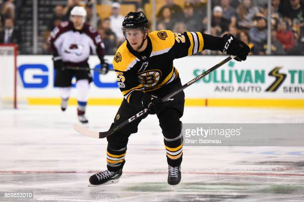 Brandon Carlo of the Boston Bruins skates against the Colorado Avalanche at the TD Garden on October 9 2017 in Boston Massachusetts