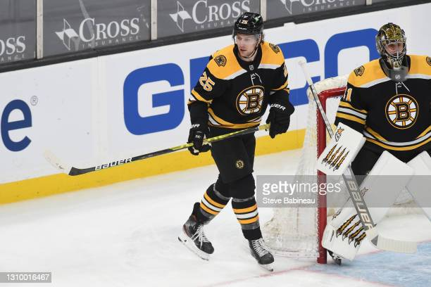 Brandon Carlo of the Boston Bruins skates against the New Jersey Devils at the TD Garden on March 30, 2021 in Boston, Massachusetts.