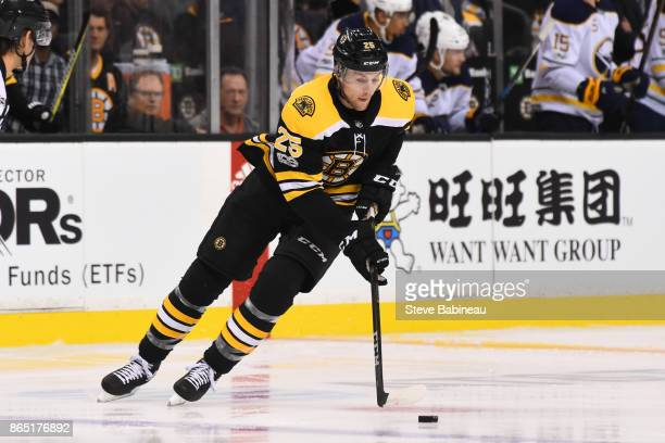 Brandon Carlo of the Boston Bruins skates with the puck against the Buffalo Sabres at the TD Garden on October 21 2017 in Boston Massachusetts