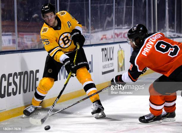 Brandon Carlo of the Boston Bruins takes a shot past Ivan Provorov of the Philadelphia Flyers during the second period of the 2021 NHL Outdoors...