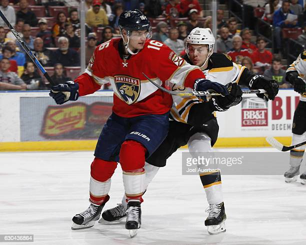 Brandon Carlo of the Boston Bruins ties up Aleksander Barkov of the Florida Panthers as he skates icon net during first period action at the BBT...