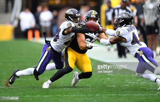 Brandon Carr and Marlon Humphrey of the Baltimore Ravens break up a pass intended for Vance McDonald of the Pittsburgh Steelers during the second...