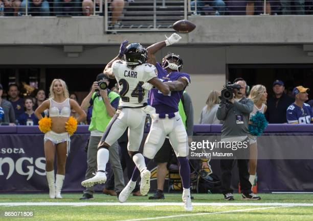 Brandon Carr of the Baltimore Ravens breaks up a pass to Laquon Treadwell of the Minnesota Vikings in the first quarter of the game on October 22...
