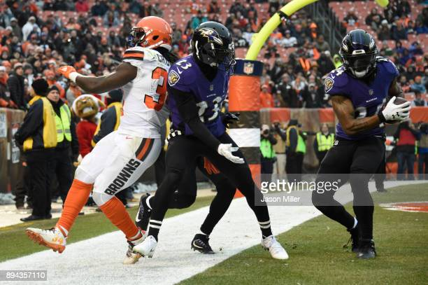 Brandon Carr of the Baltimore Ravens catches an interception for a touch back in the fourth quarter against the Cleveland Browns at FirstEnergy...