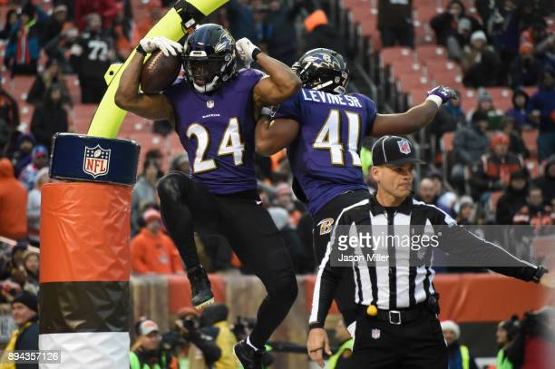 Brandon Carr of the Baltimore Ravens celebrates a touch back in the fourth quarter against the Cleveland Browns at FirstEnergy Stadium on December 17...