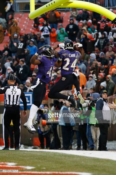 Brandon Carr of the Baltimore Ravens celebrates an interception for a touchback in the second half against the Cleveland Browns at FirstEnergy...