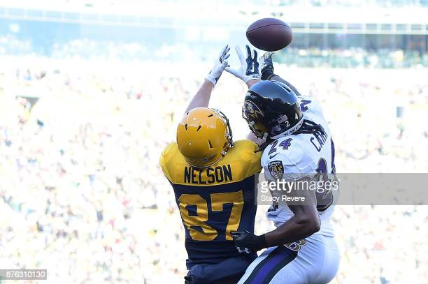 Brandon Carr of the Baltimore Ravens defends a pass intended for Jordy Nelson of the Green Bay Packers during the first half at Lambeau Field on...