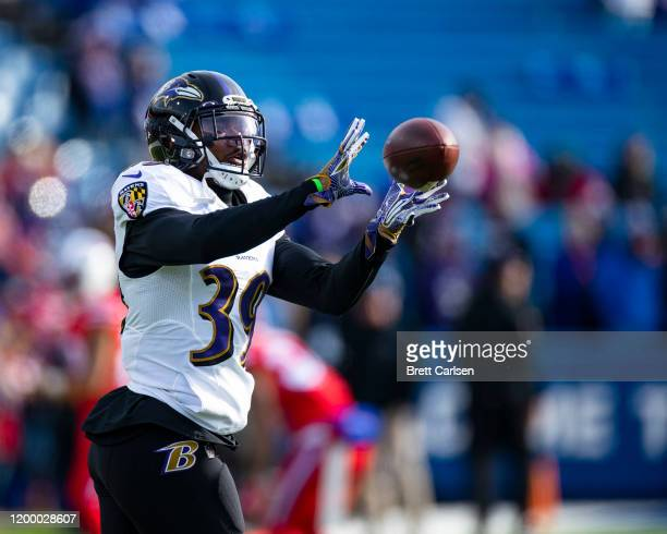Brandon Carr of the Baltimore Ravens warms up before the game against the Buffalo Bills at New Era Field on December 8, 2019 in Orchard Park, New...