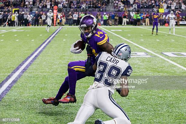 Brandon Carr of the Dallas Cowboys tackles Stefon Diggs of the Minnesota Vikings in the fourth quarter of the game on December 1 2016 at US Bank...