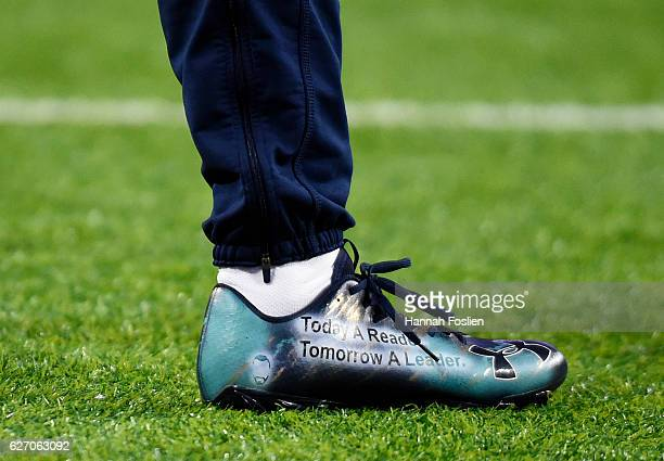 Brandon Carr of the Dallas Cowboys wears personalized cleats during pregame warmups before facing the Minnesota Vikings on December 1 2016 at US Bank...