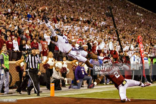 Brandon Carter of the TCU Horned Frogs jumps but cannot reach a pass in the end zone during a game against the Oklahoma Sooners at Gaylord Family...
