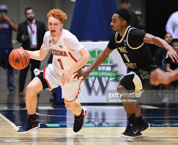 Brandon Childress of the Wake Forest Demon Deacons guards Nico Mannion of the Arizona Wildcats as he takes the ball down court in the second half of...