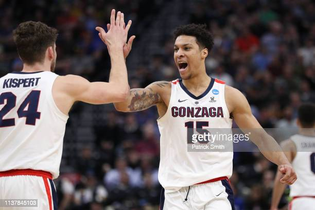 Brandon Clarke and Corey Kispert of the Gonzaga Bulldogs react to a play against the Baylor Bears during their game in the Second Round of the NCAA...