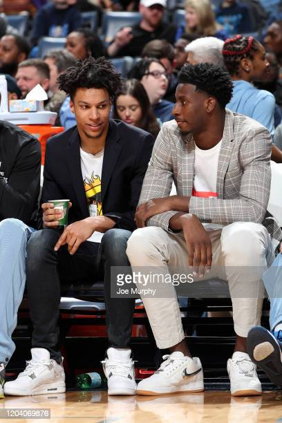 Brandon Clarke and Jaren Jackson Jr #13 of the Memphis Grizzlies look on during the game against the Sacramento Kings on February 28 2020 at...