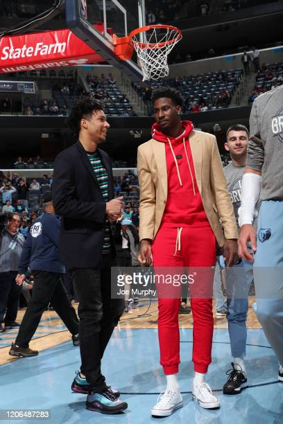 Brandon Clarke and Jaren Jackson Jr #13 of the Memphis Grizzlies talk to each other before the game against the Orlando Magic on March 10 2020 at...