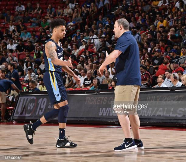 Brandon Clarke hifives coach Taylor Jenkins of the Memphis Grizzlies during the game against the Minnesota Timberwolves during the Finals of the Las...