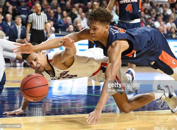 Brandon Clarke of the Gonzaga Bulldogs and Kessler Edwards of the Pepperdine Waves go after a loose ball during a semifinal game of the West Coast...