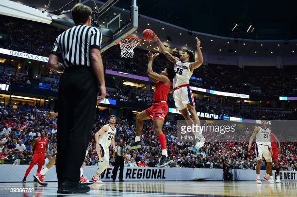 Brandon Clarke of the Gonzaga Bulldogs blocks a shot attempt by Kyler Edwards of the Texas Tech Red Raiders during the second half of the 2019 NCAA...