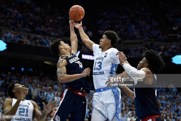 Brandon Clarke of the Gonzaga Bulldogs blocks a shot by Cameron Johnson of the North Carolina Tar Heels during the second half of their game at the...