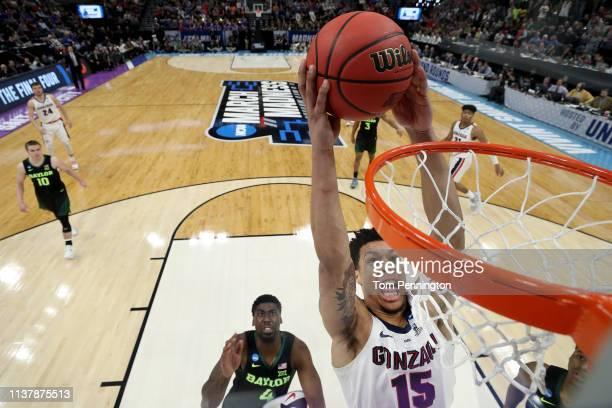 Brandon Clarke of the Gonzaga Bulldogs dunks the ball aginst Mario Kegler of the Baylor Bears in the second half of the Second Round of the NCAA...