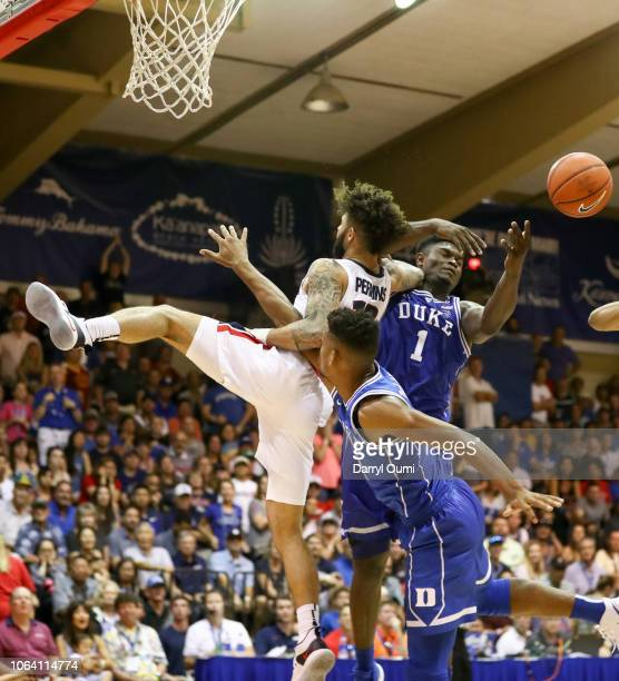 Brandon Clarke of the Gonzaga Bulldogs makes contact with Javin DeLaurier and Zion Williamson of the Duke Blue Devils before falling to the ground...