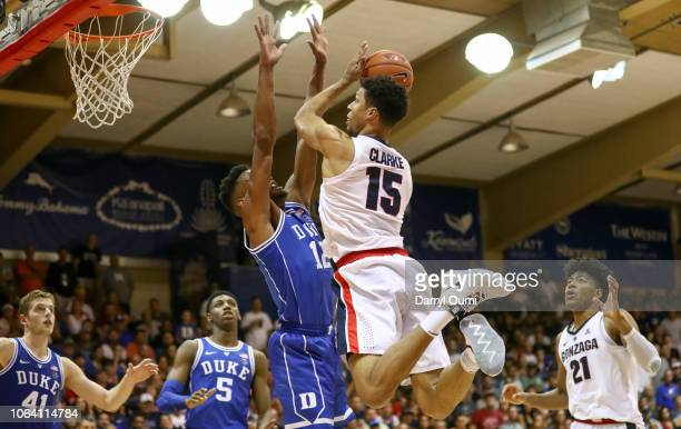 Brandon Clarke of the Gonzaga Bulldogshangs in the air before shooting over Javin DeLaurier of the Duke Blue Devils during the second half of the...