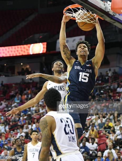 Brandon Clarke of the Memphis Grizzlies dunks against Nickeil AlexanderWalker and Jalen Adams of the New Orleans Pelicans during a semifinal game of...