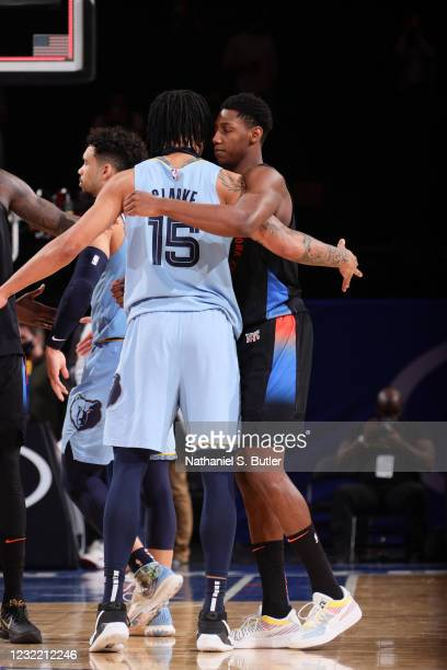 Brandon Clarke of the Memphis Grizzlies hugs RJ Barrett of the New York Knicks after the game on April 9, 2021 at Madison Square Garden in New York...