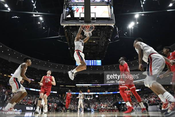 Brandon Clarke scores a slam dunk during the game against the Texas Tech Red Raiders in the Elite Eight round of the 2019 NCAA Photos via Getty...