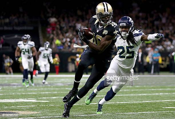 Brandon Coleman of the New Orleans Saints catches the ball against Richard Sherman of the Seattle Seahawks during the third quarter at the...