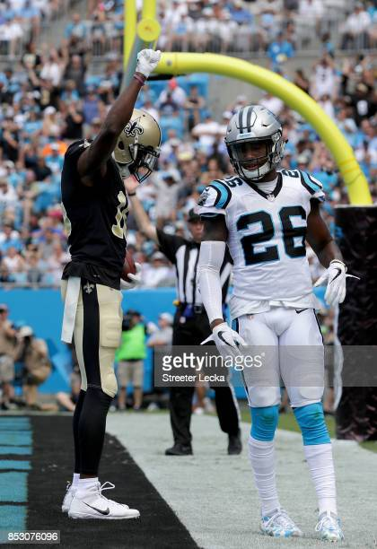 Brandon Coleman of the New Orleans Saints reacts after scoring a touchdown as Daryl Worley of the Carolina Panthers watches on during their game at...