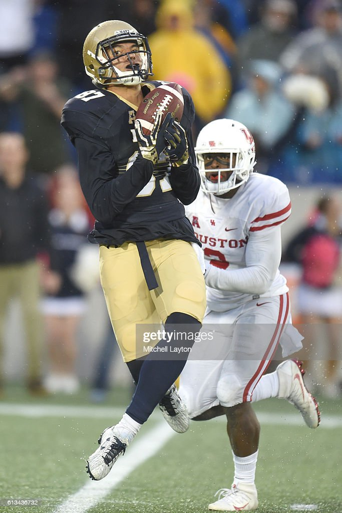 Brandon Colon #87 of the Navy Midshipmen catches a pass for a touchdown in the third quarter during a football game against the Houston Cougars at Navy-Marines Memorial Stadium on October 8, 2016 in Annapolis, Maryland.